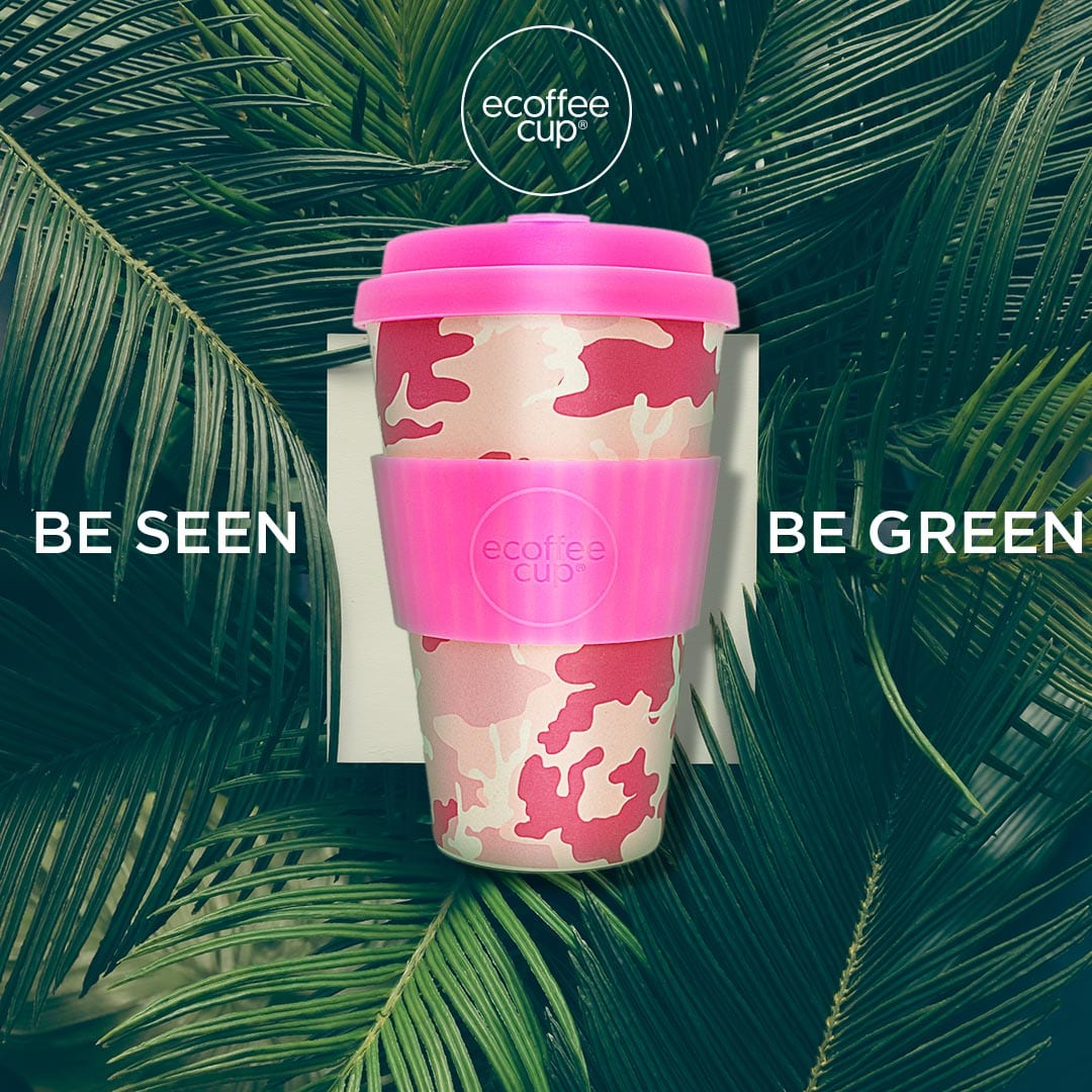 Creative tropical green leaves layout with Branded Ecoffee Cup